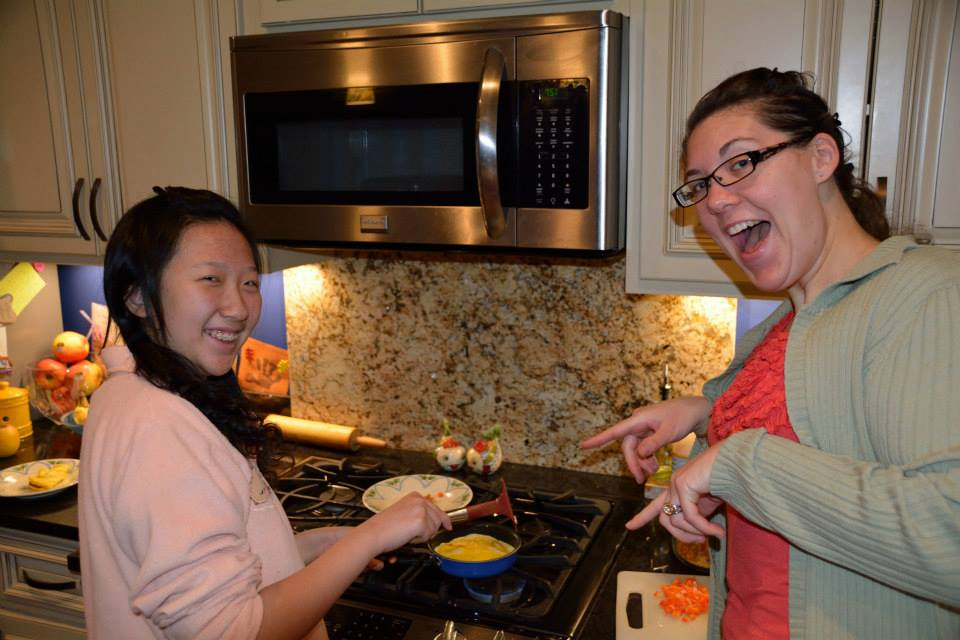 Kate Bonne and international student making dumplings