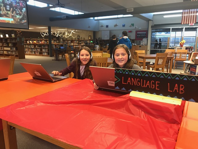 Two girls enjoy the language lab
