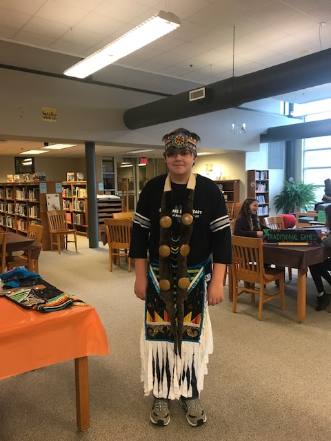 Male student donned in pow wow regalia