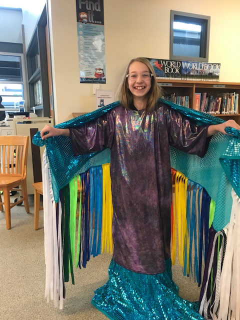 Female student donned in pow wow regalia